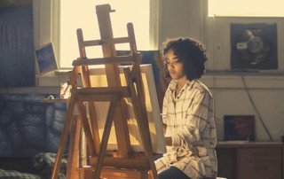 woman sitting at easel